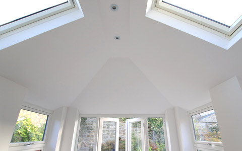 Inside a conservatory with a solid roof