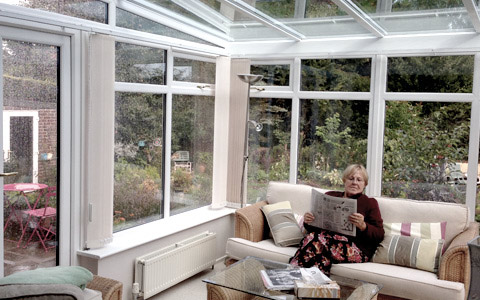 Lady reading inside a conservatory