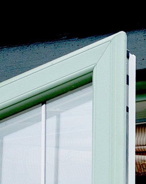Closeup of green sculptured sash window