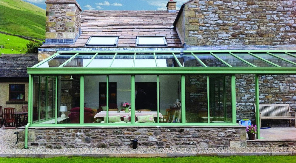 Green lean-to conservatory with Smartglass glazing