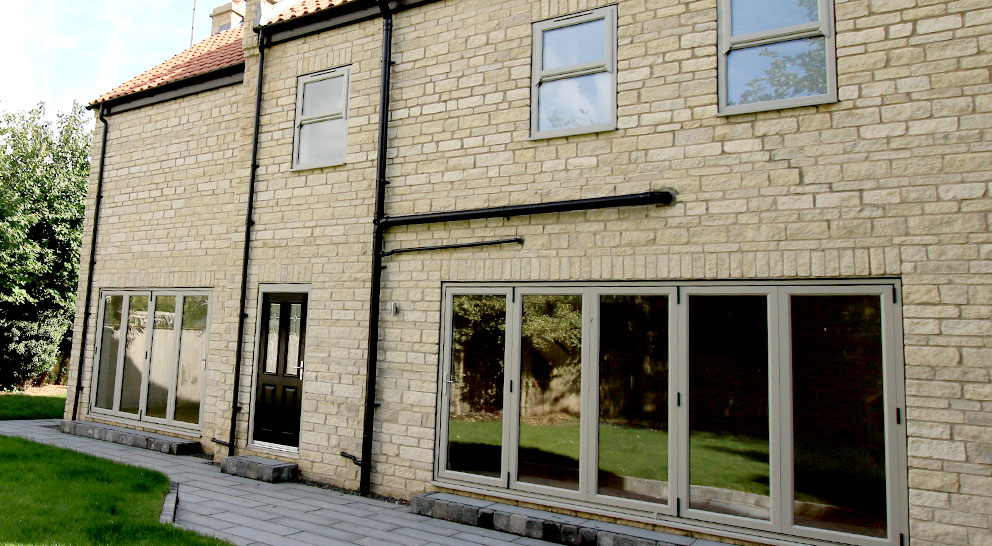 Two bi-fold doors in a stone built detached house