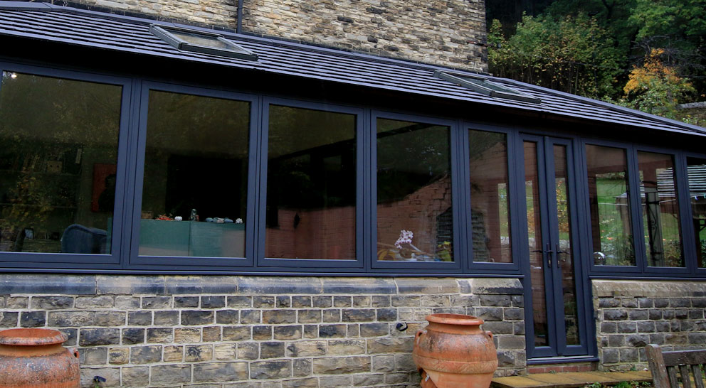 Lean to conservatory with dark frame