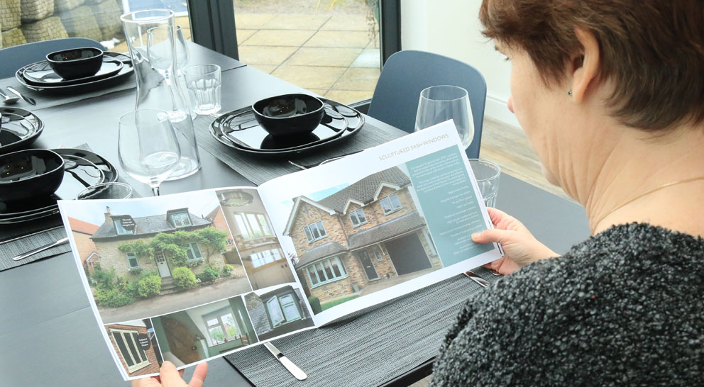 lady reading Yorkshire Windows brochure